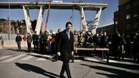 Le Premier ministre italien Giuseppe Conte à Gênes sur le site du pont effondré le 8 février 2019 [Marco BERTORELLO / AFP]