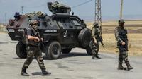 Des soldats turcs à un barrage dans le sud-est du pays [Ilyas Akengin / AFP/Archives]