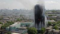 La tour Grenfell détruite par un incendie, le 14 juin 2017 à Londres [Adrian DENNIS / AFP/Archives]
