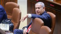 Le Premier ministre israélien Benjamin Netanyahu assiste à une session du Parlement avant le vote d'une loi controversée le 18 juillet 2018 à Jérusalem [Marc Israel Sellem / AFP]