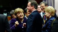 La chancelière allemande Angela Merkel et le Premier minstre  David Cameron le 17 décembre 2015 à Bruxelles [ALAIN JOCARD / AFP]