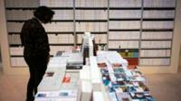 Des livres exposés à l'ouverture du Salon du Livres, le 23 mars 2017 Porte de Versailles, à Paris [ / AFP]