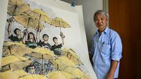 Un dessin de l'artiste hongkongais Fong So évoquant le Mouvement des parapluies en 2014, dans son studio à Hong Kong le 25 septembre 2018 [Anthony WALLACE / AFP]
