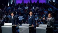 Justin Trudeau (à gauche), Andrew Scheer (au centre) et Yves-François Blanchet lors d'un débat télévisé, le 10 octobre à Gatineau (Québec)  [Chris Wattie / POOL/AFP/Archives]