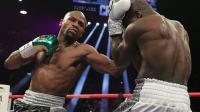 Floyd Mayweather (g) lors de son combat face à son compatriote Andre Berto à Las Vegas, le 12 septembre 2015 [John Gurzinski / AFP]
