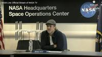 Brad Pitt en duplex avec l'astronaute Nick Hague de la NASA à bord de la Station spatiale internationale, le 16 septembre 2019 [HO / NASA TV/AFP]
