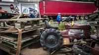 Des agriculteurs bloquaient le 11 juin 2018 l'accès au port fluvial Edouard Herriot [JEAN-PHILIPPE KSIAZEK / AFP/Archives]
