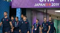 Le XV de France entre sur la pelouse du stade d'Oita (Japon) pour un entraînement à la veille de son quart de finale de Coupe du monde contre le pays de Galles, le 18 octobre 2019  [CHRISTOPHE SIMON / AFP]