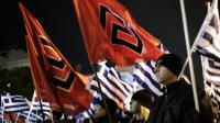 Des membres du parti néonazi grec Aube dorée lors d'un rassemblement à Athènes le 1er février 2014 [Louisa Gouliamaki / AFP/Archives]
