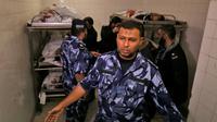 La morgue d'un hôpital où ont été entreposés les corps de cinq des six Palestiniens tués lors d'échanges de tirs à Gaza, qui ont également coûté la vie à un soldat israélien, le 11 novembre 2018 à Khan Younis [Said KHATIB / AFP]