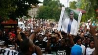 Marche en mémoire d'Adama Traoré le 22 juillet 2016 à Beaumont-sur-Oise [Thomas SAMSON / AFP]