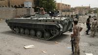 Les forces gouvernementales irakiennes patrouillent à Fallouja, le 18 juin 2016 [STRINGER / AFP]