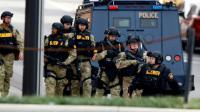 Des policiers sur un parking du campus de l'université de Columbus, le 28 novembre 2016 dans l'Ohio [Paul Vernon / AFP]