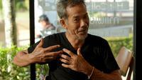 Le commandant Chaiyananta Peeranarong, ancien commando de marine thaïlandais, qui a pris part à l'évacuation des 12 enfants et de leur entraîneur de foot bloqués dans une cave inondée, lors d'un entretien avec l'AFP le 11 juillet 2018. [TANG CHHIN Sothy / AFP]