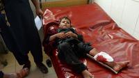 Un enfant afghan à l'hôpital de Jalalabad après une série d'explosions dans la ville afghane, le 11 septembre 2018 [NOORULLAH SHIRZADA / AFP]