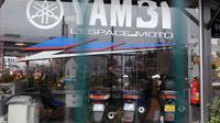 La vitrine du magasin de scooters de Toulouse où Mohammed Merah a acheté son scooter le 22 mars 2012 à Toulouse [Remy Gabalda / AFP/Archives]