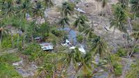 Vue aérienne du quartier dévasté de Petobo à Palu, sur l'île des Célèbes prise le 7 octobre 2018. [ADEK BERRY / AFP]
