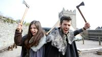 """Des Français fans de la série """"Game of Thrones"""", Claire Pottier et Hugo Chivard, en visite le 17 avril 2019 au château de Strangford en Irlande du Nord, un site de tournage de la série [PAUL FAITH / AFP]"""