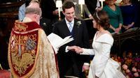 La princesse Eugenie et son compagnon Jack Brooksbank se marient à Windsor, le 12 octobre 2018. [Danny Lawson / POOL/AFP]