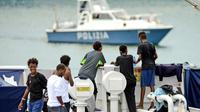 Migrants secourus à bord du Diciotti dans le port de Catane, en Sicile, le 23 août 2018 [Giovanni ISOLINO / AFP/Archives]