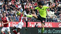 Le défenseur de Lille José Fonte (d) buteur lors du match nul à Reims 1-1 en 31e journée de L1 le 7 avril 2019 [FRANCOIS NASCIMBENI / AFP]
