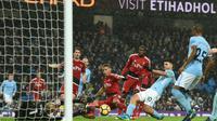 L'attaquant argentin de Manchester City marque lors du match à domicile face à Watford en 22e journée du championnat d'Angleterre le 2 janvier 2018 [Oli SCARFF                           / AFP]