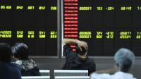 Une société de Bourse à Pékin le 25 août 2015 [FRED DUFOUR / AFP]