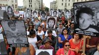 Des Péruviens manifestent contre la grâce accordée par le président Pedro Pablo Kuczynski à l'ex-président Alberto Fujimori, le 25 décembre 2017 à Lima [Juan Vita / AFP]