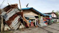 Une maison endommagée par le typhon Phanfone à Ormoc City (Philippines) le 25 décembre 2019 [RONALD FRANK DEJON / AFP]