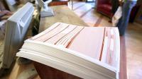 Une pile de feuilles de soins [Olivier Morin / AFP/Archives]