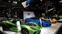 Des voitures Lotus présentées au Mondial de l'automobile le 04 octobre 2018 à Paris  [Christophe ARCHAMBAULT / AFP]