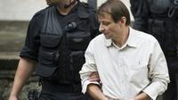 Cesare Battisti quitte un tribunal à Rio de Janeiro, le 10 décembre 2009 [ANTONIO SCORZA / AFP/Archives]