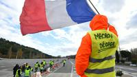 """Un """"gilet jaune"""" à un péage près de Marseille, le 9 décembre 2018 [SYLVAIN THOMAS / AFP]"""