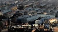 Camions-citernes brûlés après une attaque de talibans près de Kaboul, le 5 juillet 2014 [Wakil Kohsar / AFP]