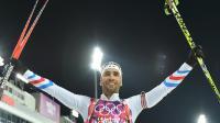 Le biathlète français Martin Fourcade célèbre sa victoire en poursuite au complexe Laura à Rosa Khoutor, le 10 février 2014 [ / AFP]