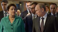 La présidente du Brésil Dilma Rousseff et le président russe Vladimir Poutine lors de la finale de la Coupe du monde de football à Rio, le 13 juillet 2014  [Aleksey Nikolskyi  / Pool Ria Novosti/AFP]