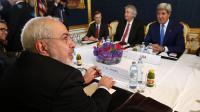 Le ministre iranien des Affaires étrangères Javad Zarif (gauche) lors d'une rencontre avec le secrétaire d'Etat américain John Kerry à Vienne le 14 juillet 2014 [Jim Bourg / Pool/AFP/Archives]