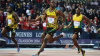 Le sprinteur jamaïcain Kemar Bailey-Cole (C) remporte le 100 m des Jeux du Commonwealth, le 28 juillet 2014 à Glasgow [ / AFP]