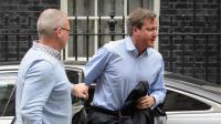 Le Premier ministre britannique David Cameron de retour à son bureau du 10 Downing Street, dans le centre de Londres le 20 août 2014 [Leon Neal / AFP]