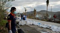 Un pompier recense les victimes du typhon Haiyan à Tacloban aux Philippines, le 19 novembre 2013 [ / AFP/Archives]