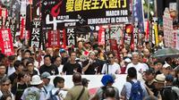 """Entre 2.000 et 3.000 personnes défilent le 1er juin 2014 à Hong Kong, peu avant le 25e anniversaire de l'écrasement du """"printemps de Pékin"""" en 1989 [Anthony Wallace / AFP]"""