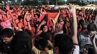 Des supporters fêtent la victoire de l'Allemagne à Copacabana le 13 juillet 2014 [Tasso Marcelo / AFP]