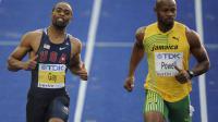 Le sprinteur jamaïcain Asafa Powell (d) et l'Américain Tyson Gay disputent la demi-finale du 100m aux Championnats du monde d'athlétisme de Berlin, le 16 août 2009 [ / DDP/AFP/Archives]