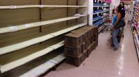 Rayonnages vides dans un magasin à Caracas, le 17 juin 2014 [Leo Ramirez / AFP]