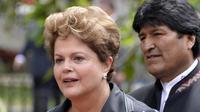 La présidente brésilienne Dima Roussef et son homologue bolivien Evo Morales le 29 juillet 2014 à Caracas [Leo Ramirez / AFP]