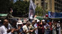Des partisans du président islamiste déchu Mohamed Morsi célèbrent l'Aïd el-Fitr, le 8 août 2013 au Caire [Gianluigi Guercia / AFP Photo]