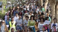 Des Africaines, accompagnées de leurs enfants, manifestent à Tel-Aviv contre le refus des autorités israéliennes de leur accorder le statut de réfugié, le 15 janvier 2014 [Jack Guez / AFP]