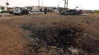 Les dégats causés par l'explosion d'une voiture piéger à l'académie militaire de Benghazi le 17 mars 2014 [Abdullah Doma / AFP/Archives]