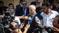 Mohamed Damaty, membre d'un groupe d'avocats défendant 42 partisans du président islamiste déchu Mohamed Morsi, le 27 avril 2014 au Caire [Mohamed El-Shahed / AFP]