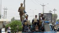 Des forces de sécurité irakiennes patrouillent dans Kirkourk, le 13 juin 2014 pour freiner l'arrivée des jihadistes [MARWAN IBRAHIM / AFP]
